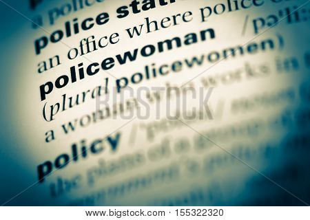 Close Up Of Old English Dictionary Page With Word Policewoman