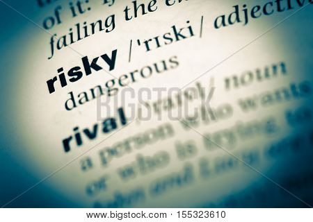 Close Up Of Old English Dictionary Page With Word Risky