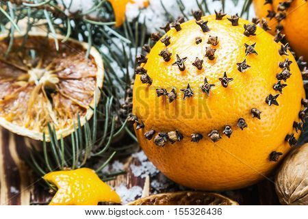 Christmas decorations and Christmas oranges on a wooden table and snow