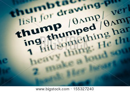 Close Up Of Old English Dictionary Page With Word Thump