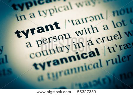 Close Up Of Old English Dictionary Page With Word Tyrant