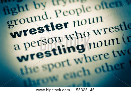 Close Up Of Old English Dictionary Page With Word Wrestler