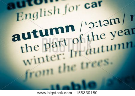 Close Up Of Old English Dictionary Page With Word Autumn
