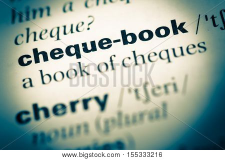 Close Up Of Old English Dictionary Page With Word Cheque Book