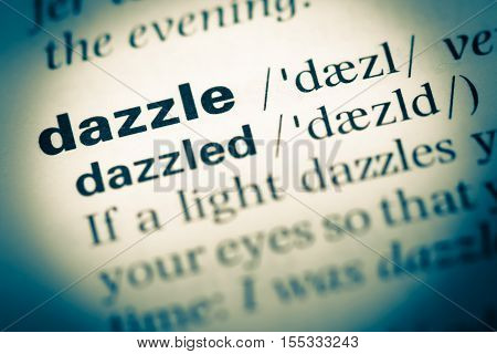 Close Up Of Old English Dictionary Page With Word Dazzle