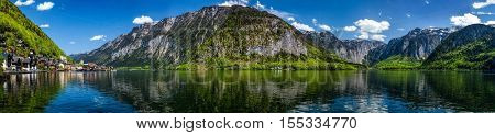 Austrian tourist destination - panorama of Hallstatt village and Hallstatter See mountain lake in Austria in Austrian alps. Salzkammergut region, Austria