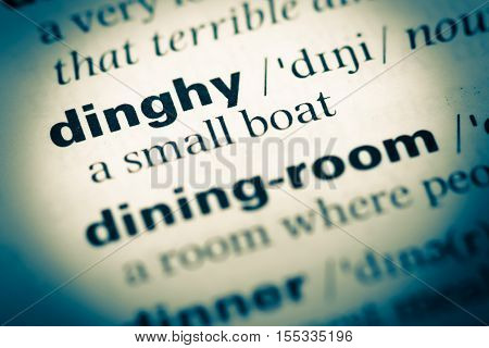 Close Up Of Old English Dictionary Page With Word Dinghy