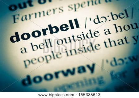 Close Up Of Old English Dictionary Page With Word Doorbell