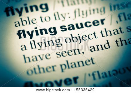Close Up Of Old English Dictionary Page With Word Flying Saucer
