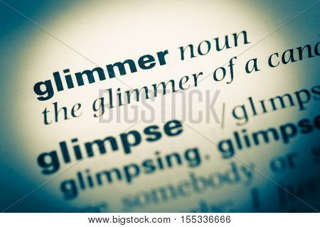 Close Up Of Old English Dictionary Page With Word Glimmer