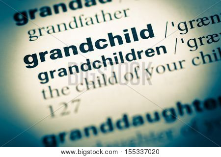 Close Up Of Old English Dictionary Page With Word Grandchild