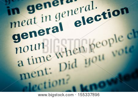 Close Up Of Old English Dictionary Page With Word General Election