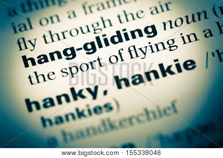 Close Up Of Old English Dictionary Page With Word Hang Gliding