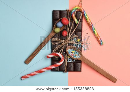 Chocolate Bar And Sweets On Colorful Background