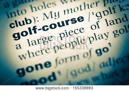 Close Up Of Old English Dictionary Page With Word Golf Course