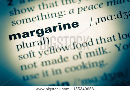 Close Up Of Old English Dictionary Page With Word Margarine