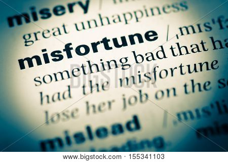 Close Up Of Old English Dictionary Page With Word Misfortune