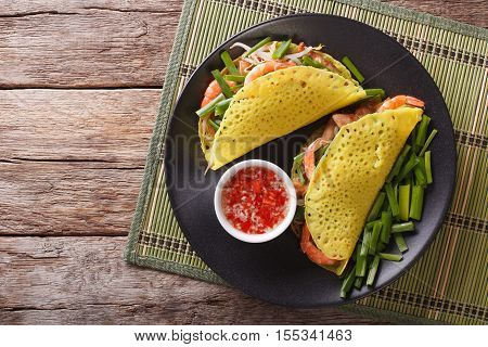Banh Xeo Crepes Stuffed With Pork, Shrimp, Onions, Bean Sprouts And Spicy Sauce Closeup. Horizontal