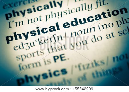 Close Up Of Old English Dictionary Page With Word Physical Education