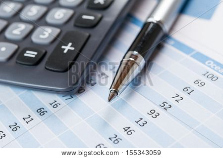 Business and finance concept, pen and calculator on a spreadsheet