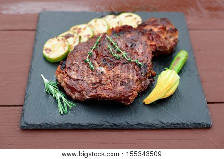 Rib eye steak with vegetables a on slate plate