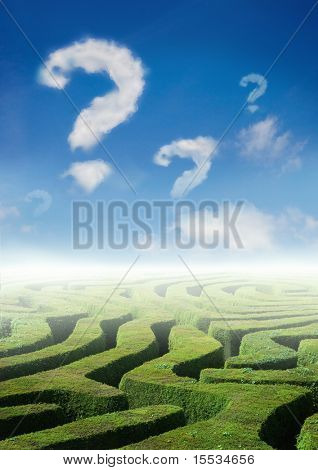 Conceptual photo with a maze and clouds of question marks