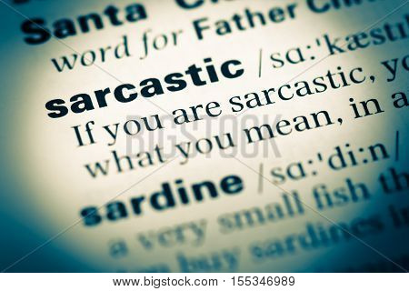 Close Up Of Old English Dictionary Page With Word Sarcastic