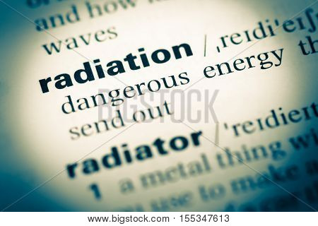 Close Up Of Old English Dictionary Page With Word Radiation