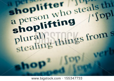 Close Up Of Old English Dictionary Page With Word Shoplifting