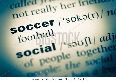 Close Up Of Old English Dictionary Page With Word Soccer