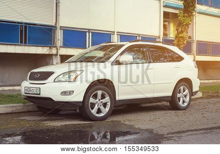 Sochi, Russia - October 10, 2016: Lexus RX in sunlight parked near house.