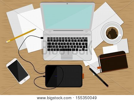 Realistic workplace organization. Top view with wood textured table, laptop, smartphone, diary, graphics tablet, paper with a pencil and cup of coffee. Work desk for office with stationery elements on the table.