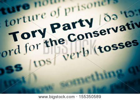 Close Up Of Old English Dictionary Page With Word Tory Party
