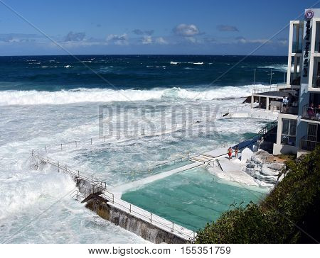 Bondi Iceberg's swimming pools with ocean view at high tide. Big tide at Bondi beach the waves fill the Icebergs Club pool.