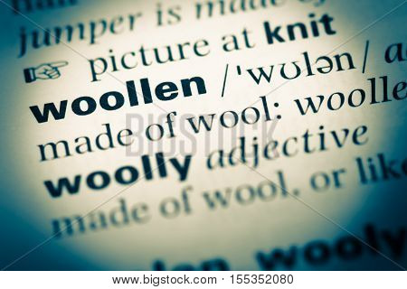 Close Up Of Old English Dictionary Page With Word Woollen