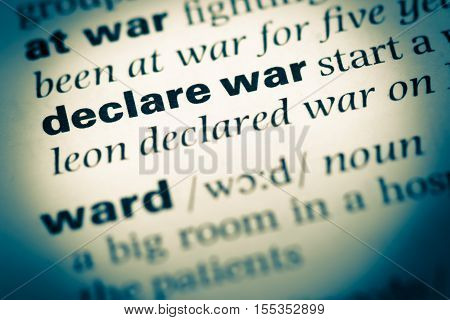 Close Up Of Old English Dictionary Page With Word Declare War