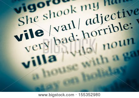 Close Up Of Old English Dictionary Page With Word Vile