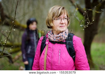 Active mid age hiker admiring beauty of the nature on early spring