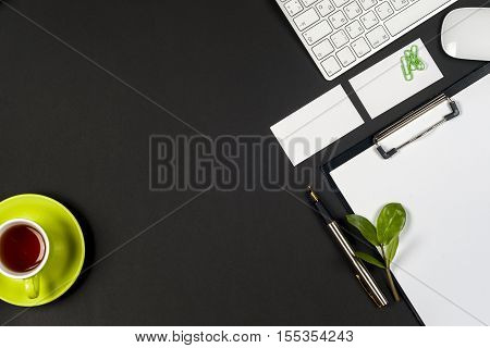 Office desk table with white computer supplies. Top view with copy space