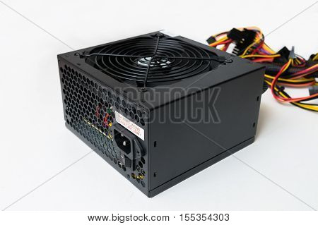 Closeup View On Computer Power Supply On White Background.