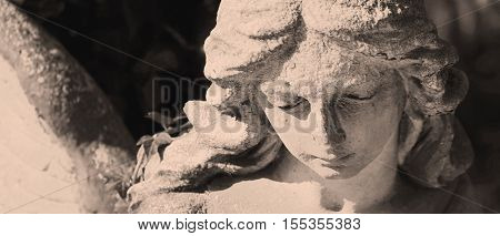 sad angel as a symbol of eternity life and death