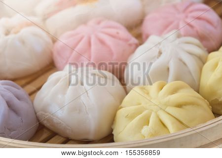 The steamed stuffed buns or steamed dumpling buns in bamboo steam boiler Nikuman in Japanese language