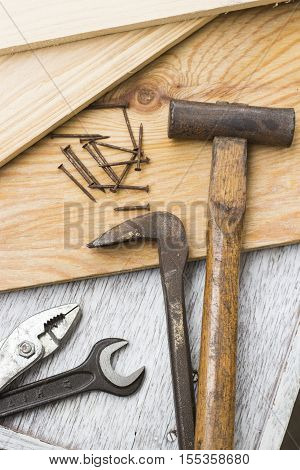 Wooden boards Hammer wrench plyer and nails carpenter's tools