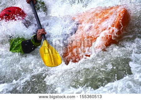 Extreme river kayaking as fun sport. Splashing the white water