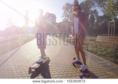 Longboarding, skateboarding, fun sport in a city park