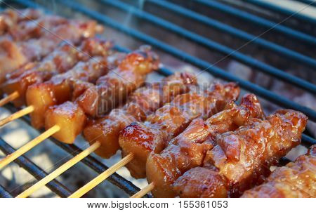 Smoke of Thai styled pork babeque on grille