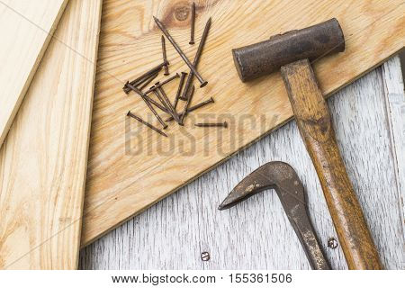 Wooden boards Hammer nail puller and nails carpenter's tools
