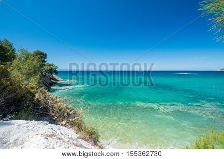 Beautiful rocky Greek coastline and clear blue sea.