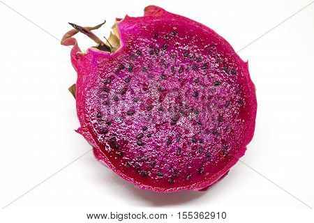 Pitaya on white background. Isolated dragon fruit with fresh cut. Pink pine with sweet flesh and black seeds. Exotic fruit for dessert or breakfast. Vegetarian or diet food. Natural shape and taste