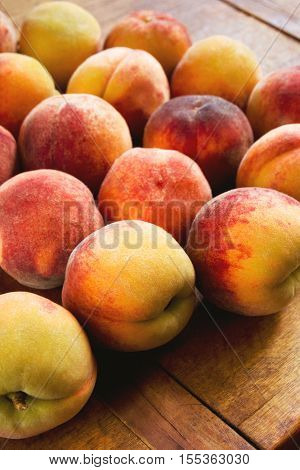 Sweet silky peaches on the wooden kitchen table